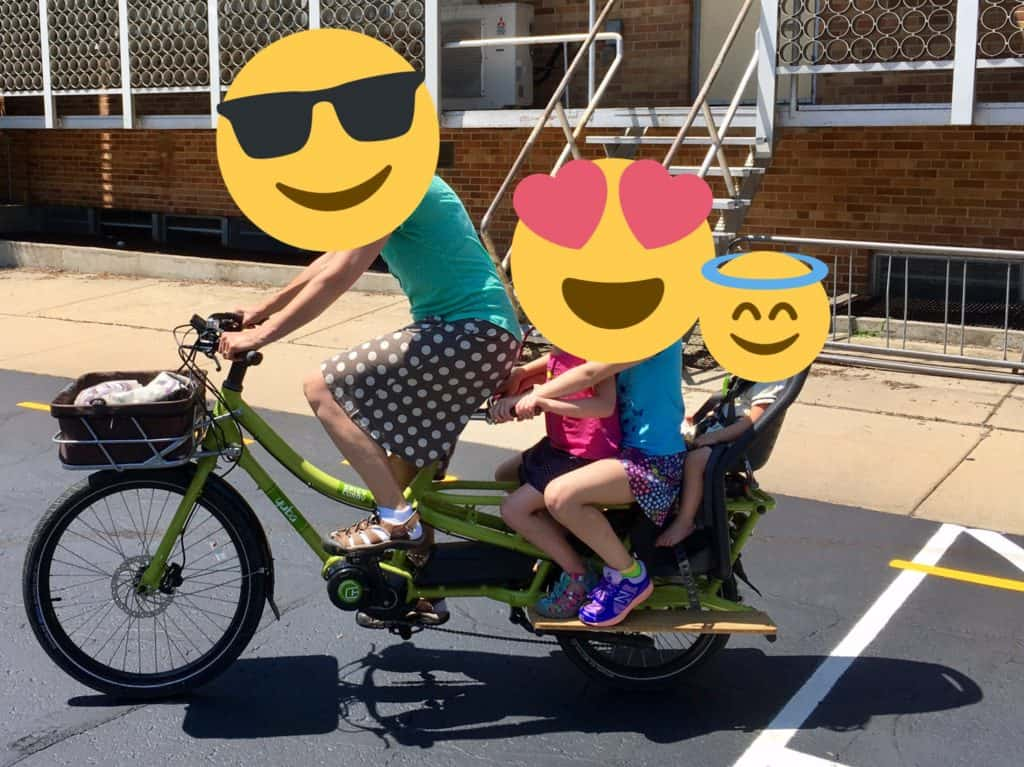 Picture of our family riding a cargo bike